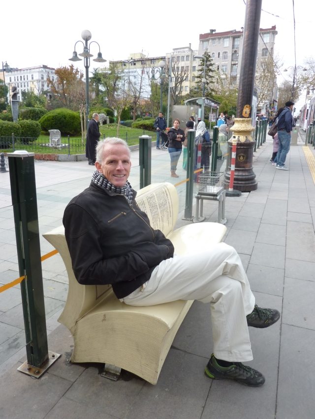 Now isn't that a cute book-bench?  KC waiting for the tram, one of Istanbul's 5 modes of public transportation.