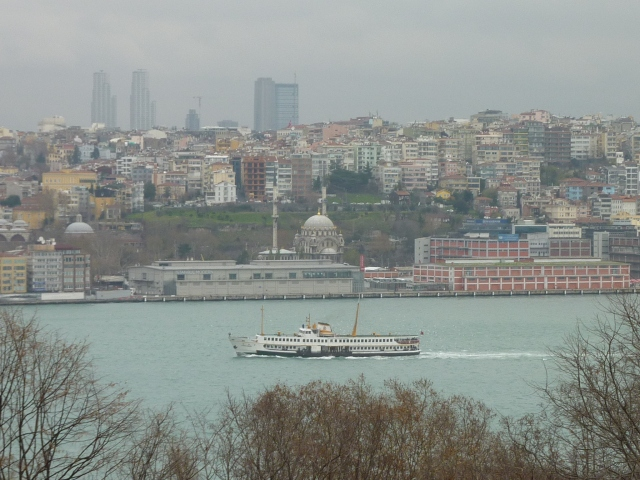 Notice the ship heading into the Straits in the foreground, the mosque along the waterfront, and the city in the background.  I think this photo represents Istanbul nicely.  (Too bad it's so overcast.)