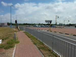 Paved bike path along busy street in Gaborone
