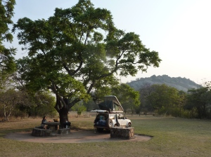 "Campsite with ""Hill Complex"" in background"